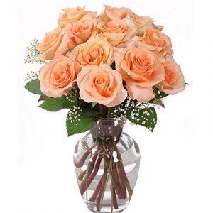 peach roses in vase
